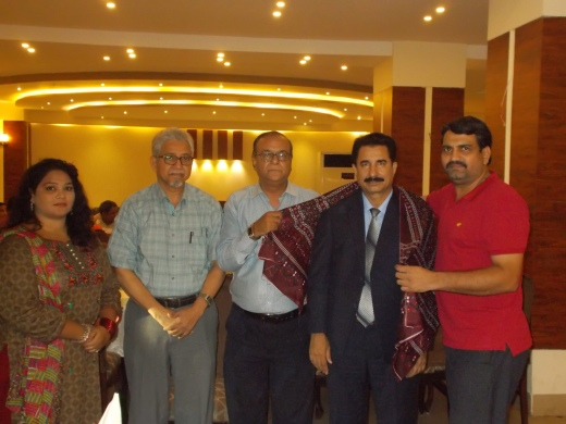 Mujeebur Rehman Khan Presents Ajrak to Mr.Noorullah Bughio