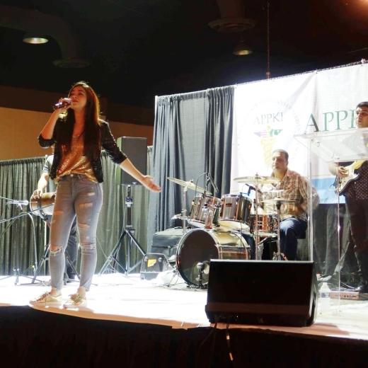 Komal Rizvi on stage in Kentucky
